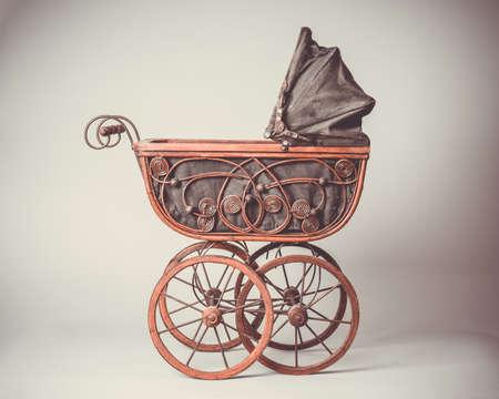 Old Victorian pram with vintage tone