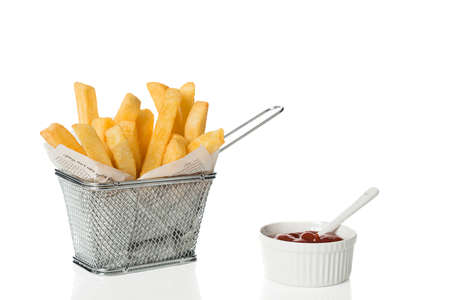 Portion of freshly cooked chips with a bowl of tomato sauce on a white background