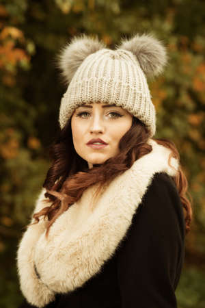 Beautiful young woman dressed for autumn in the British countryside
