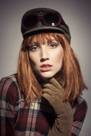 Portrait of a young woman in retro vintage sixtiesseventies era style