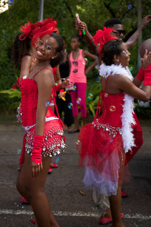 creole: Victoria, Seychelles - April 26, 2014: Coca-Cola dancers at the Carnaval International de Victoria in Seychelles Editorial