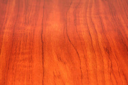 graining: red wood finish on a slab, showing saturated reds and intricate graining