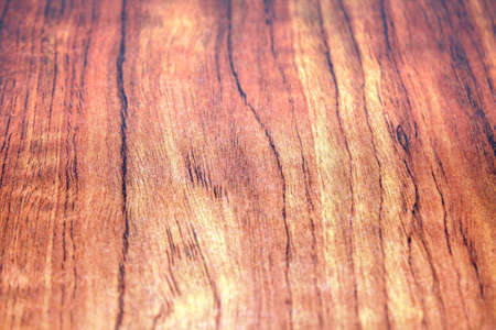 graining: red wood finish on a slab, showing subdued colours and finer wood graining details