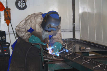 Man conentrating on welding