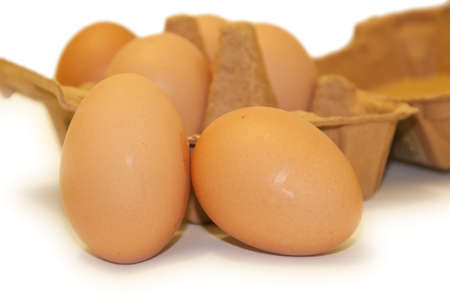 Eggs displayed with a carton Stock Photo