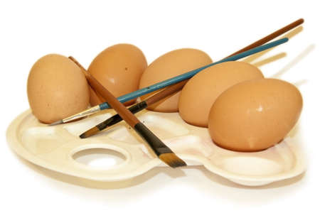 Eggs and brushes on a palette