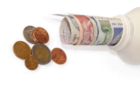 moola: South African money (and coins) in a bottle isolated on a white background Stock Photo