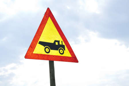 tractor warning: Warning road sign showing construction vehicle  truck Stock Photo