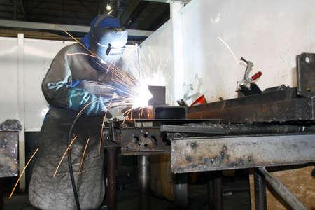 Factory worker arc welding Stock Photo