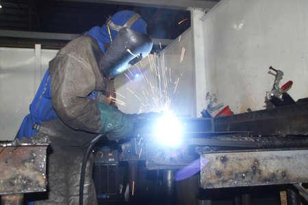 Artisan welding in a factory photo