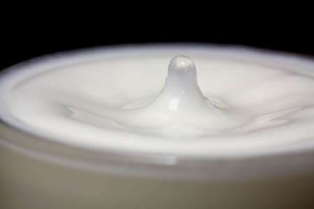Droplet of water in a glass of milk Stock Photo - 5393009