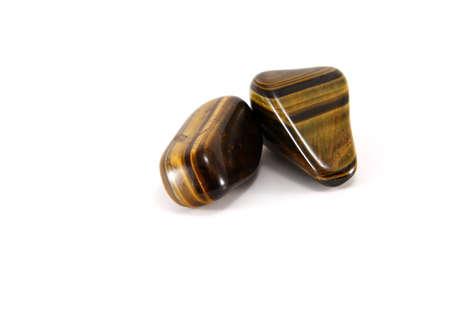 Two tigers eye gemstones isolated on white Stock Photo - 5608240