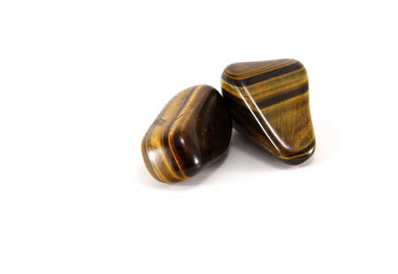 Two tigers eye gemstones isolated on white Stock Photo - 5608240