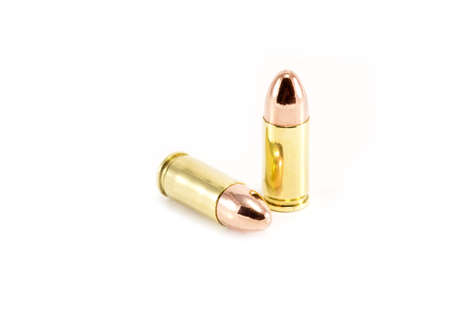 Two 9mm bullets on white Stock Photo