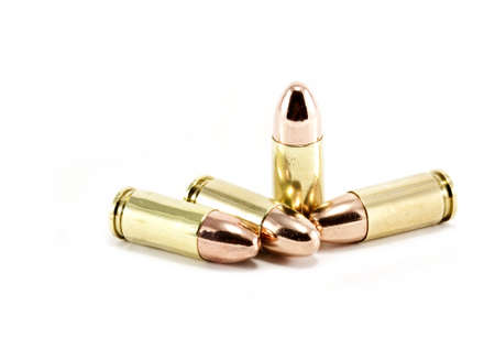 Four 9mm bullets on white
