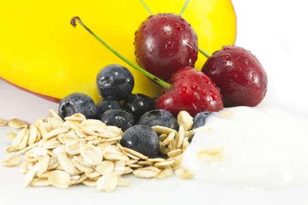 Smoothie Ingredients including Mango, Berries, Oats, Yogurt and Cherries