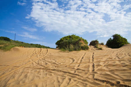 Beach dunes used as a 4x4 trail in Mozambique with a dramatic blue sky (polarised). Stock Photo