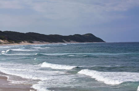 subtropical: Beautiful tranquil beach in Mozambique, with sub-tropical waters and lush hills. Stock Photo