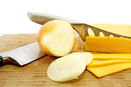 Cheese and Onion with knives Stock Photo