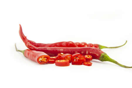 Sliced red chillies on white Stock Photo