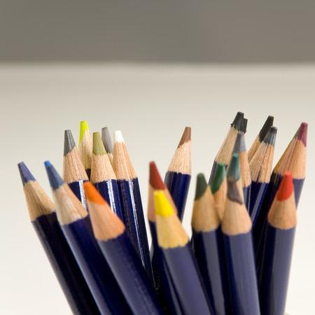 Artists watercolour pencils in a pot close-up