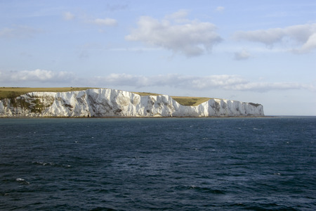 Europe, England. Kent, early morning sun on the White cliffs of Dover viewed from cross channel ferry
