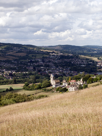 View over Selsey village and church to Stroud on the edge of the Cotswold Hills, Gloucestershire, UK