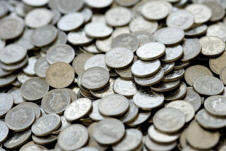 Close up of many UK 5 pence silver coins