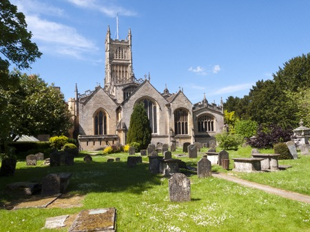 The historic Abbey Church and churchyard at Cirencester in the Cotswolds, Gloucestershire, UK Stock Photo