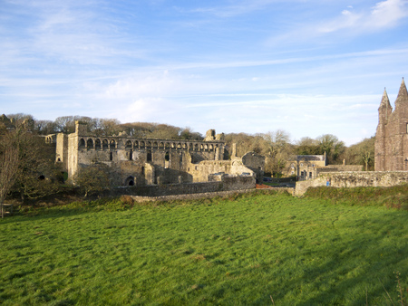 Winter afternoon sunshine on the famous ruins of the medieval Bishops Palace in the UK's smallest city of St Davids, Pembrokeshire, Wales, UK