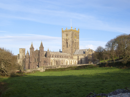 Winter afternoon sunshine on the famous cathedral in the UK's smallest city of St Davids, Pembrokeshire, Wales, UK