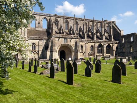 Historic Malmesbury Abbey in spring sunshine, Wiltshire, UK Stock Photo