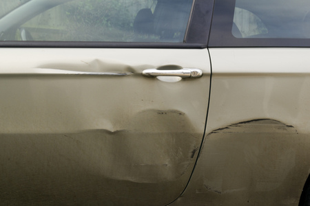 Dents in the side of car