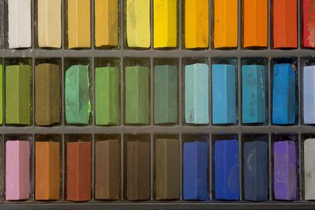 Multi coloured artists pastel crayons pattern close up Archivio Fotografico