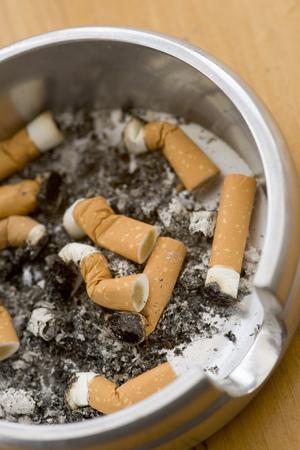 Ashtray full of extinguished cigarette butts