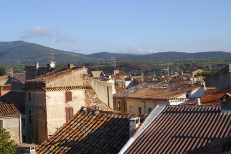 Lots of TV aerials on rustic rooftops of a small town in rural South-West France