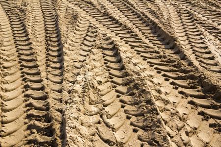 Tractor tyre tracks in beach sand Stock fotó