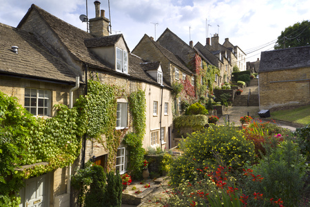 The picturesque old cottages of The Chipping Steps, Tetbury, Cotswolds, Gloucestershire, UK