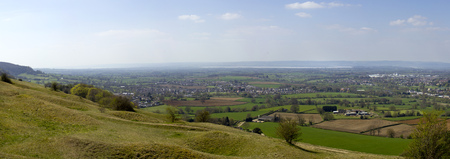 Panoramic view from Selsey Common towards the River Severn and the Forest of Dean over a patchwork of fields in The Severn Vale, Gloucestershire, UK. Stitched panorama.