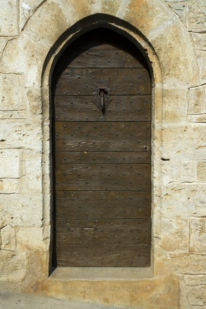 Ancient studded wood building entrance door Stock Photo