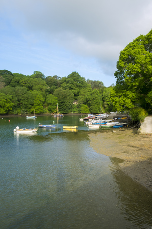 Peaceful early summer morning on picturesque boat moorings in the Helford Estuary at old fashioned Port Navas, Cornwall, UK
