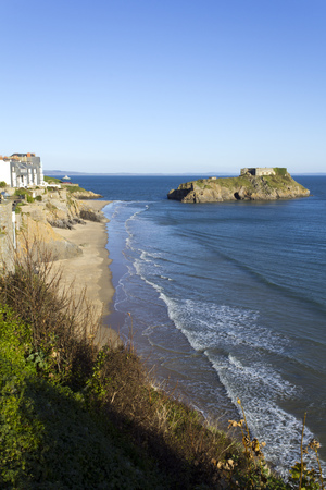 UK, Wales, Pembrokeshire, vibrant blue sky and sea in winter sunshine looking towards St Catherines Island, Tenby