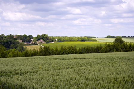 The tiny Cotswold hamlet of Hampnett in idyllic rolling rural countryside, Gloucestershire, UK