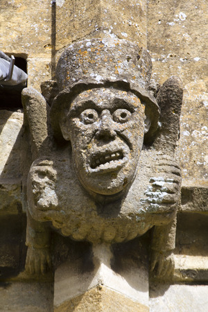 Grotesque gargoyles on the historic Cotswold church at Winchcombe, Gloucestershire, UK. Stok Fotoğraf