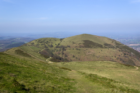 The view from Worcestershire Beacon shows a network of footpaths that criss-cross the Malvern Hills, Worcestershire, UK Фото со стока