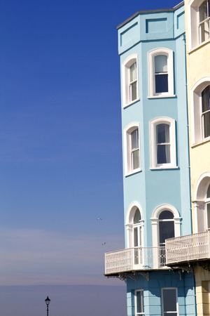 Colourful hotel frontages against a vibrant blue sky in Tenby, Pembrokeshire, Wales, UK