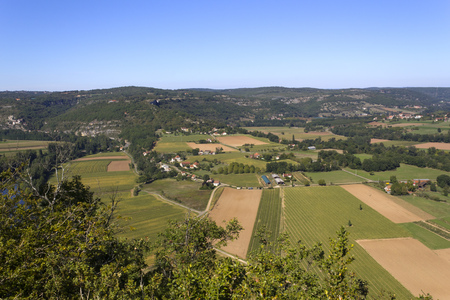 View over patchwork fields and farms in the Lot Valley from Saut de la Mounine viewpoint near Cajarc, Lot, Quercy, France