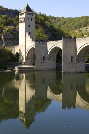 Europe, France, Midi Pyrenees, Lot, Cahors, the historic Pont Valentre fortified bridge reflected in the Lot River