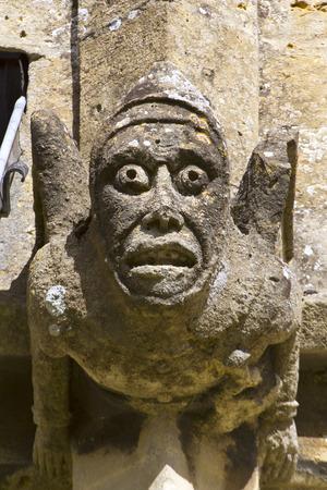 Grotesque gargoyles on the historic Cotswold church at Winchcombe, Gloucestershire, UK. Stock Photo