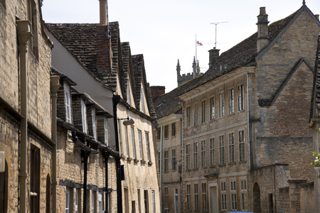 Quaint and historic buildings line the streets in the older parts of Cirencester, Gloucestershire, UK